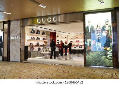 Singapore - JAN 6, 2019: Interior view of Gucci store at Singapore Changi Airport. Gucci is an Italian luxury brand of fashion and leather goods, which is owned by the French holding company Kering.
