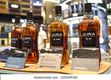 Singapore - JAN 6, 2019: Jura Single malt Scotch Whiskey on store shelf in Changi Airport. Jura is a Scotch whisky distillery on the island of Jura in the Inner Hebrides off the West Coast of Scotland