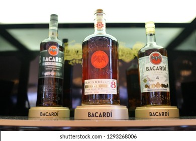 Singapore - JAN 6, 2019: Rows of Bacardi Rum alcoholic beverages on store shelf. Barcardi is the largest privately held, family-owned spirits company in the world.