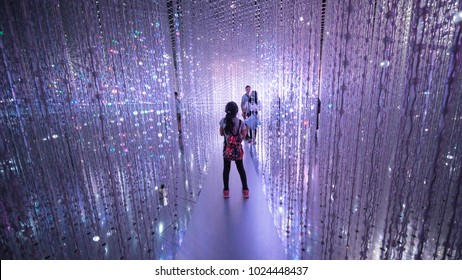 Singapore - January 04, 2018: Visitors walking inside the ArtScience Museum Singapore while looking at magical light