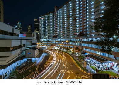 Singapore, Singapore - January, 05: Light trails on Singapore roads with high rise buildings taken at night on January 05, 2017