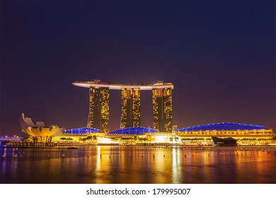 SINGAPORE - JANUARY 1, 2014,  : The Marina Bay Sands complex in the night -  Marina Bay Sands is an integrated resort and billed as the world's most expensive standalone casino property