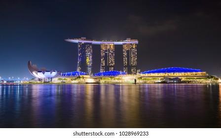 SINGAPORE - JANUARY 10, 2018: Panorama of Singapore city skyline with Marina Bay Sands hotel and ArtScience Museum at night. Popular travel destination.