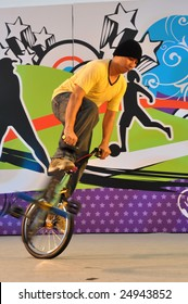 SINGAPORE - JANUARY 10: Teen performing stunts on bicycle during Singapore 2010 Youth Olympic Games logo launch ceremony January 10, 2009 in Singapore