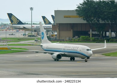 SINGAPORE - JANUARY 10: Xiamen Airlines Boeing 737-800 regional jet taxiing at Changi Airport on January 10, 2015 in Singapore