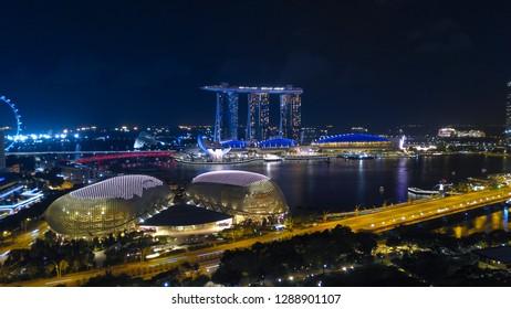 SINGAPORE - JANUARY 12, 2019: Aerial photo of Singapore cityscape at dusk. Landscape of Singapore business building around Marina bay.