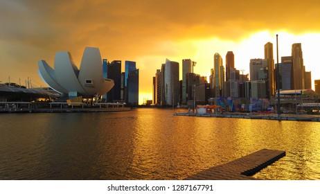 SINGAPORE - JANUARY 13, 2019: Cityscape of Singapore during sunset. Landscape of Singapore business building around Marina bay.