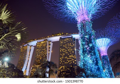 Singapore - January 13, 2019: The Super trees and Marina Bay Sands - hotel and casino on the shore of Marina Bay in the city center.