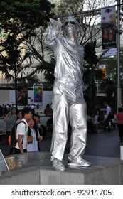 SINGAPORE - JANUARY 13: Unidentified foreigner performing robot dancer on the street to earn a living on 13 January, 2012 in Orchard Road, Singapore.