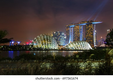 SINGAPORE - January 14, 2017 : Marina Bay Sands hotel at night with light show. Skyline and Cityscape of Singapore city at night.