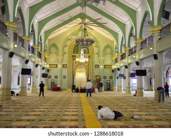 SINGAPORE - JANUARY 14 2019: People praying in the main hall of Masjid Sultan or Sultan Mosque on January 14, 2019 in Singapore.