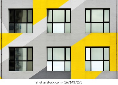 Singapore - January 14 2020: Six modern windows on exterior of office building with yellow and grey pattern in Jalan Besar, Singapore