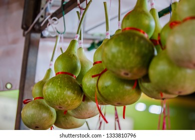 Singapore, Singapore - January 16, 2016: calabash on sale on a store in Chinatown, Singapore. It is also known as bottle gourd, white-flowered gourd, Lagenaria siceraria and long melon.