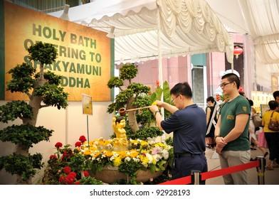 SINGAPORE - JANUARY 17: Holy Bath offering to Shakyamuni Duddha at Ngee Ann City Civic Plaza on January 17, 2012 in Singapore Orchard Road.