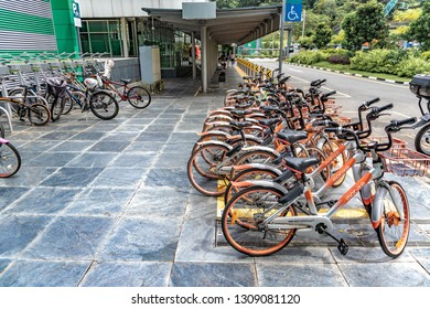 SINGAPORE - JANUARY 19 2019 : A group of Mobike rental/bike sharing bicycles parked outside of fort canning mrt