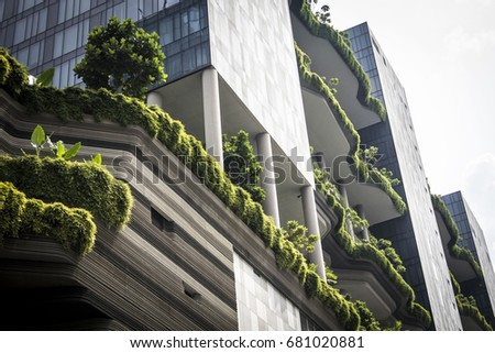91521721281d Singapore - January 2017  Residential or business building in Singapore  downtown with plant decorated balconies