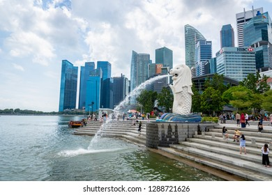 Singapore - January 2019: Visitors at Merlion Park in Singapore city center. Merlion is a famous landmark in Singapore and popular for tourists.