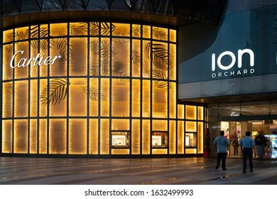Singapore, January 2020.  the stores in front of the entrance of ION Orchard shopping mall at sunset
