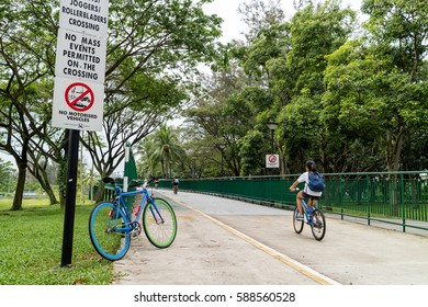 SINGAPORE - JANUARY 25, 2017_Cyclists, Joggers, Rollerbladers crossing from the East Coast Park to the Gardens By the Bay, Singapore