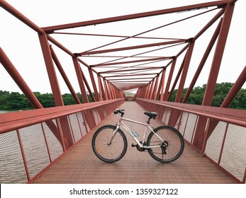 SINGAPORE - JANUARY 26, 2017_Bicycle and the Lorong Halus Bridge at Punggol Waterways, Singapore. Tourists can walk across the Lorong Halus Bridge from the Punggol side across the Serangoon River