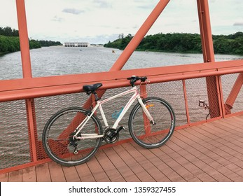 SINGAPORE - JANUARY 26, 2017_Bicycle and the Lorong Halus Bridge at Punggol Waterways, Singapore. Tourists can walk across the Lorong Halus Bridge from the Punggol side across the Serangoon River