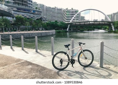 SINGAPORE - JANUARY 26, 2017_Bicycle parked at Waterway Point with background of Public Housing Apartments. Waterway Point is a suburban shopping mall located in the town centre of Punggol New Town