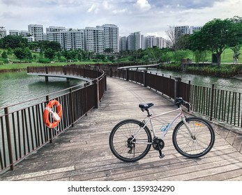 SINGAPORE - JANUARY 26, 2017_Bicycle parked at Singapore Public Housing Apartments area in Punggol District, Singapore. Housing Development Board(HDB)