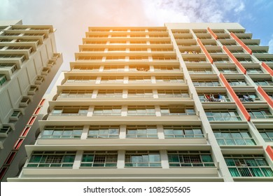 SINGAPORE - JANUARY 26, 2017_low angle view of Singapore Public Housing Apartments in Punggol District, Singapore. Housing Development Board(HDB), low-rise condominium with sunlight effect