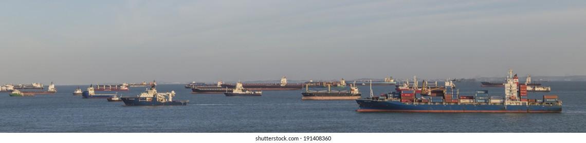 SINGAPORE, SINGAPORE - JANUARY 29, 2014: Many cargo ships waiting off the coast of Singapore