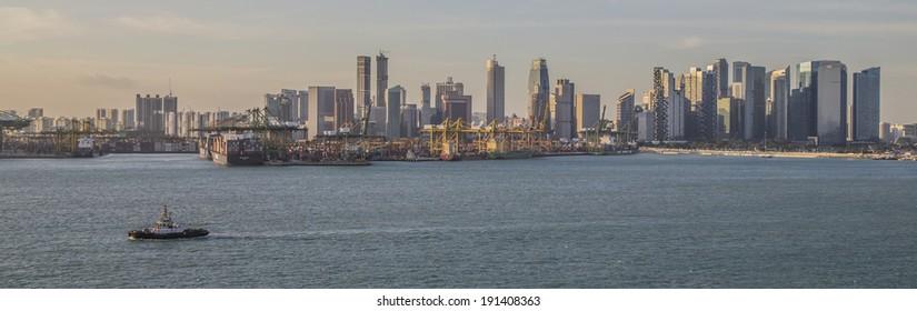 SINGAPORE, SINGAPORE - JANUARY 29, 2014:Panoramic view of the container port and skyline of Singapore