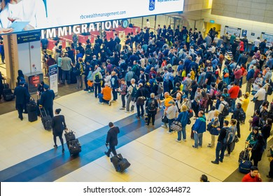 SINGAPORE, SINGAPORE - JANUARY 30, 2018: Above view of crowd of people waiting in queue at arrival immigration of Changi airport. Changi International Airport serves more than 100 airlines operating 6