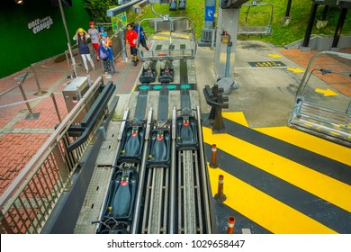 SINGAPORE, SINGAPORE - JANUARY 30, 2018: Above view of black carts in a railway in Sentosa Skyride Luge, Singapore
