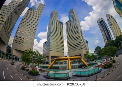 SINGAPORE, SINGAPORE - JANUARY 30. 2018: Beautiful outdoor view of fountain wealth with a public residential condominium building complex and downtown skylines at Kallang neighborhood in Singapore