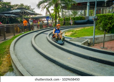 SINGAPORE, SINGAPORE - JANUARY 30, 2018: Close up of man riding of in a Sentosa Skyride Luge, in Singapore