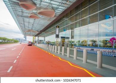 SINGAPORE, SINGAPORE - JANUARY 30, 2018: Outdoor view of Taxi cabs waiting outside the terminal at Singapore Changi Airport SIN , ranked by Skytrax the best airport in the world in 2016