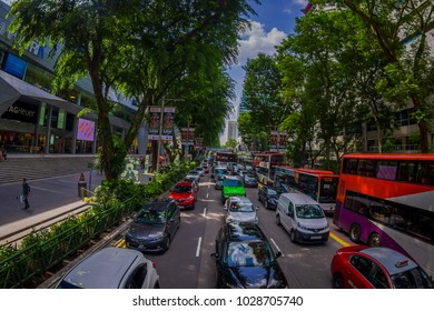 SINGAPORE, SINGAPORE - JANUARY 30. 2018: Outdoor view of heavy traffic in the streets of the city close to a public residential condominium buildings complex and downtown skylines at Kallang