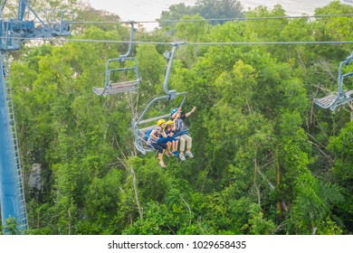 SINGAPORE, SINGAPORE - JANUARY 30, 2018: Outdoor view of unidentified people at Singapore Sentosa Cable Car and Skyline Luge, Singapore