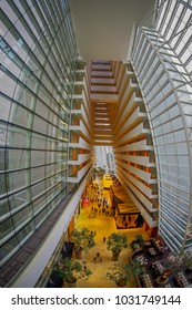 SINGAPORE, SINGAPORE - JANUARY 31, 2018: Beautiful above view of interior luxurious lobby of Marina Bay Sands Hotel in Singapore, fish eye effect