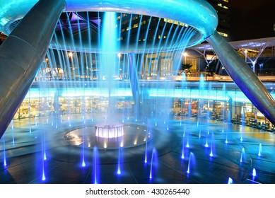 SINGAPORE - JANUARY 5 : Fountain of Wealth with Suntec Towers on January 5,2015 in Singapore. Fountain of wealth is the biggest fountain in Singapore located Suntec Towers, Singapore.