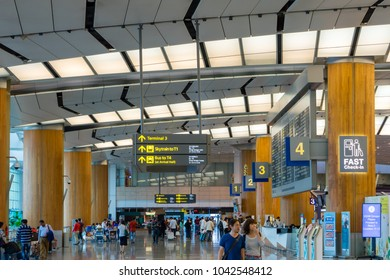 Singapore - January 6, 2018: Visitors walk around Departure Hall in Changi Airport. It has 3 passenger terminals, one of the largest transportation hubs in Asia and serves more than 100 airlines