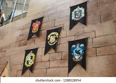 Singapore, Singapore / Singapore - January 7 2019: Wizarding World: Holiday at Changi - black felt banner flags of Hogwarts Houses