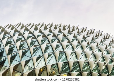 Singapore - Jul 14, 2018 : Architectural roof detail of Esplanade - Theatres on the Bay, with blue cloudy sky background.