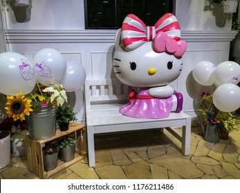 Singapore - Jul 2018: Cute Kitty figure sitting on a white bench decorated at one corner of Hello Kitty Orchid Garden, Changi Airport