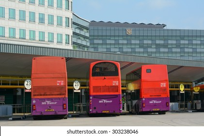 Singapore - Jul 24, 2015. Public commuter buses at a busy bus terminal in Singapore. SBS Transit is a bus and rail operator in Singapore and carries close to three million passengers daily.