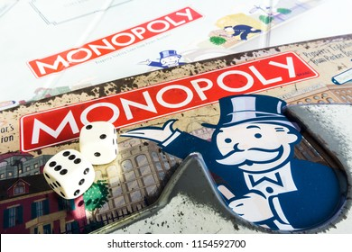 Singapore - Jul 25, 2018:  Monopoly Board Game close up with the box, board and dices. The classic real estate trading game from Parker Brothers was first introduced to America in 1935.
