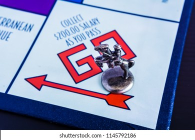 Singapore - Jul 26, 2018:  Monopoly Board Game close up with the horse token passing the GO. The classic real estate trading game from Parker Brothers was first introduced to America in 1935.