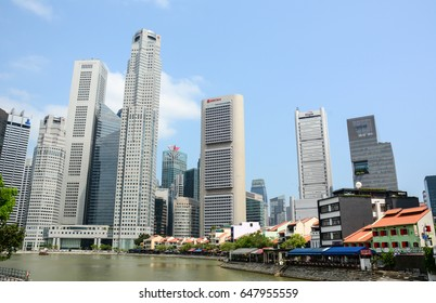 Singapore - Jul 3, 2015. Modern buildings at business district in Singapore. Singapore is global financial center with a tropical climate and multicultural population.