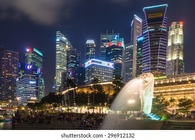 SINGAPORE - JULY 09: The Merlion fountain lit up at night on July 09, 2015 in Singapore. Singapore is a world famous tourist city with highly developed economic infrastructure.