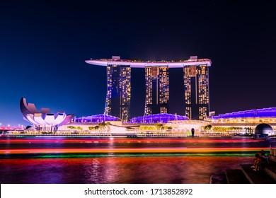 Singapore - July 1, 2019 - Iconic Hotel Marina Bay Sands near Downtown Core night panorama