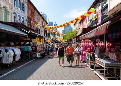 SINGAPORE - JULY 10: Tourists shopping at traditional China Town market place on July 10, 2015 at Singapore. Singapore's Chinatown is a world famous bargain shopping destination.
